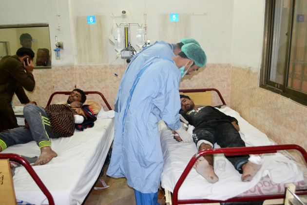 Medical workers treat an injured policeman at hospital after militants attacked the Balochistan Police...