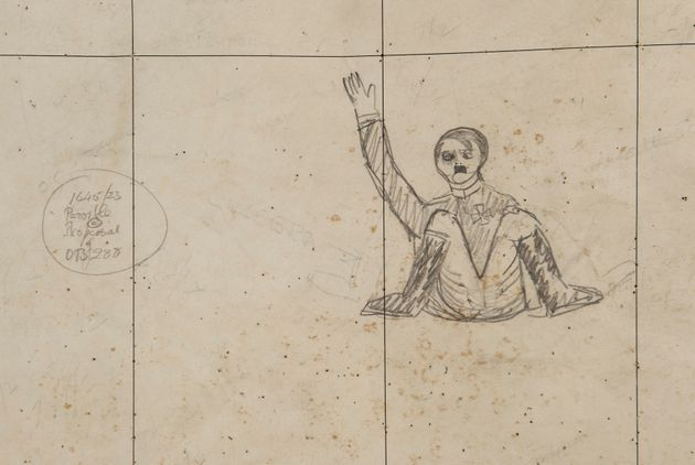A mocking cartoon of Adolf Hitler waves out from a