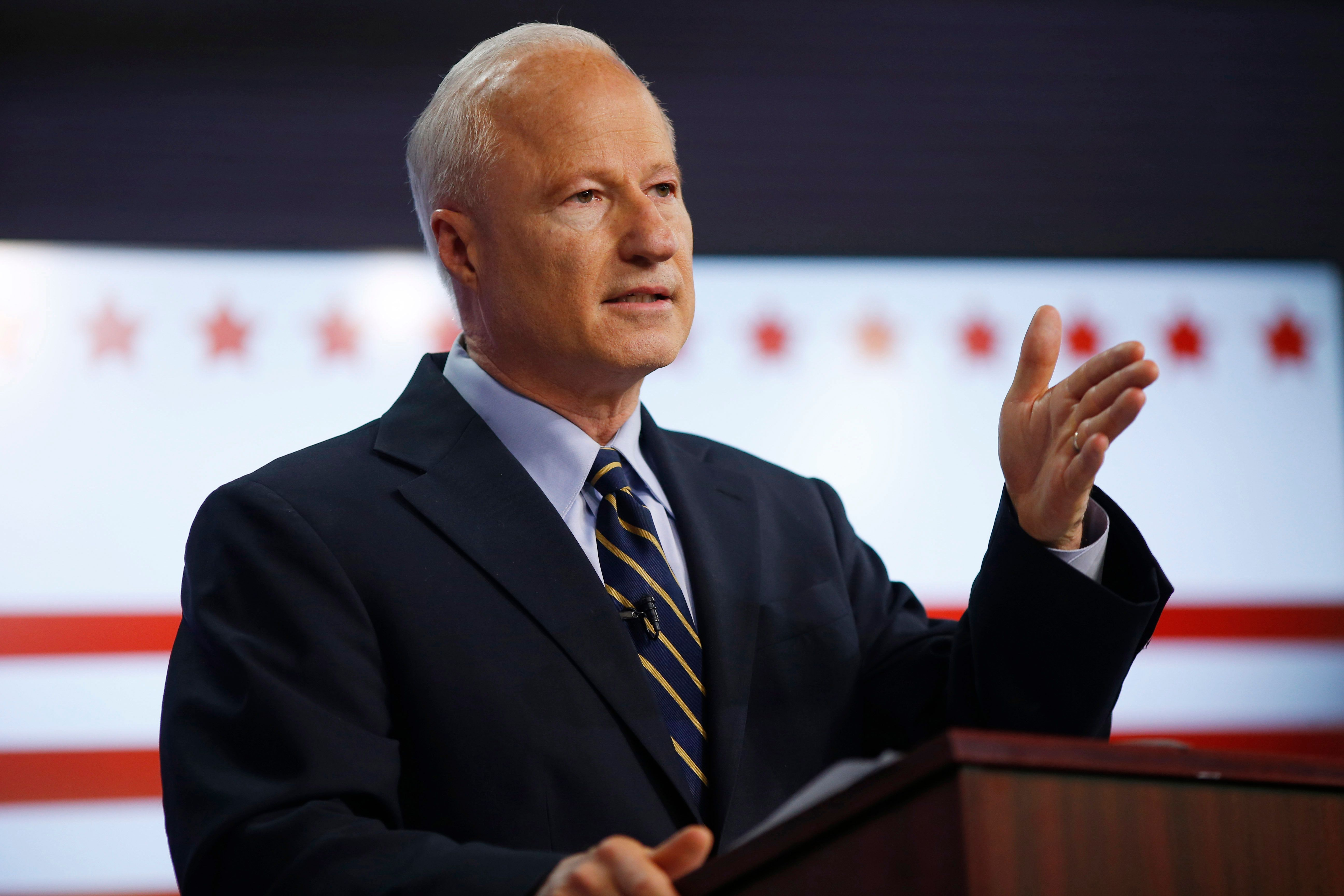 In this Tuesday, Oct. 4, 2016, photo, U.S. Congressman Mike Coffman, R-Colo., makes a point during a debate with his opponent for Colorado's 6th Congressional District seat, Democrat Morgan Carroll, at a Spanish language television station in Denver. (AP Photo/David Zalubowski)