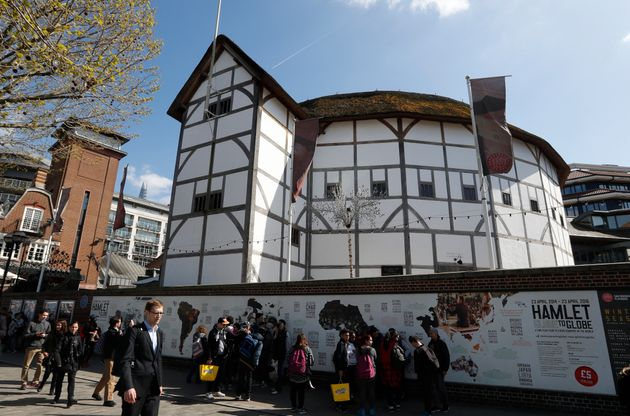 A view The Globe Theatre nestled alongside contemporary buildings on the banks of the River Thames in