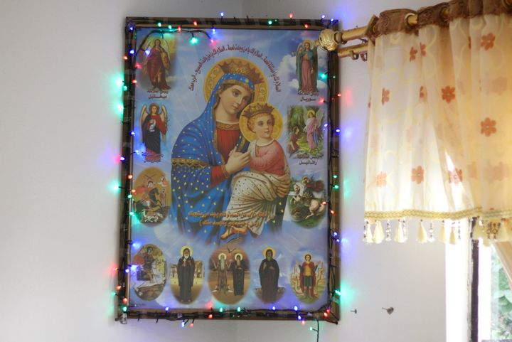 A portrait of the Virgin Mary and Jesus hangs in a family's home in Maghara, Iraq.