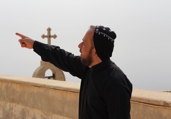 The Rev. Thomas stands on the roof of Mar Mattai -- a reportedly 1600-year-old Christian monastery, known as o