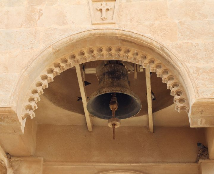 Birds perch and sing inside of a bell tower at Mar Mattai Monastery.