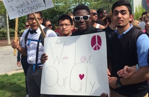 Warshan (right) at a peaceful march in Baltimore during the 2015 protests