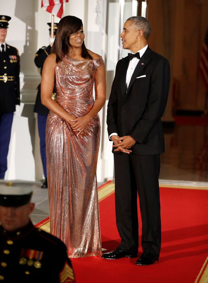 President Barack Obama and the first lady await arrival of the Italian Prime Minister before their final State Dinner at the
