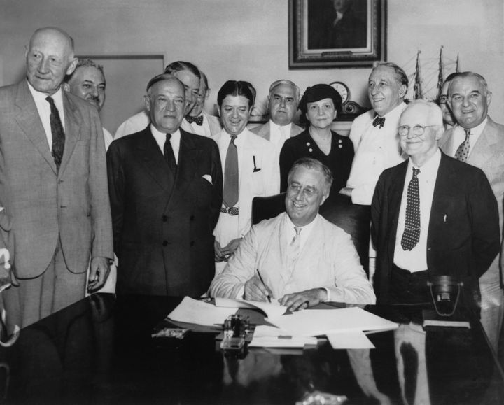 President Franklin Delano Roosevelt signs the Social Security Act on Aug. 14, 1935.