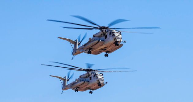 TwoMarine CorpsCH-53E Super Stallionhelicopters fly in formation.