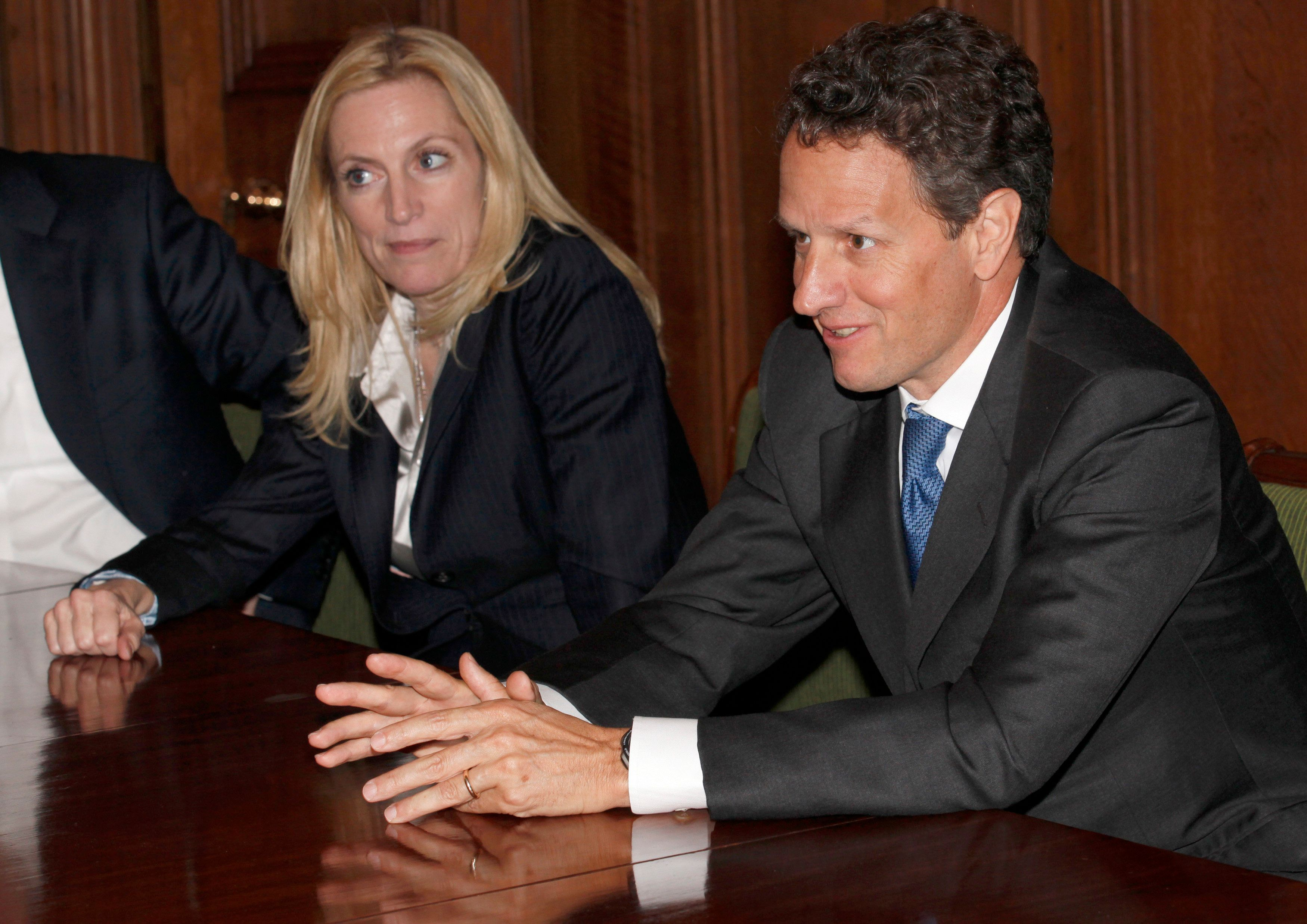 U.S. Treasury Secretary Timothy Geithner (R), with the U.S. Undersecretary of the Treasury for International Affairs, Lael Brainard, speaks during a meeting with Britain's Chancellor of the Exchequer, George Osborne, at 11 Downing Street in central London May 26, 2010. U.S. Treasury Secretary Timothy Geithner said on Wednesday there should be a coordinated global approach to financial reform as he kicked off a short European tour to discuss the latest developments in the euro zone crisis.     REUTERS/Suzanne Plunkett (BRITAIN - Tags: BUSINESS POLITICS)