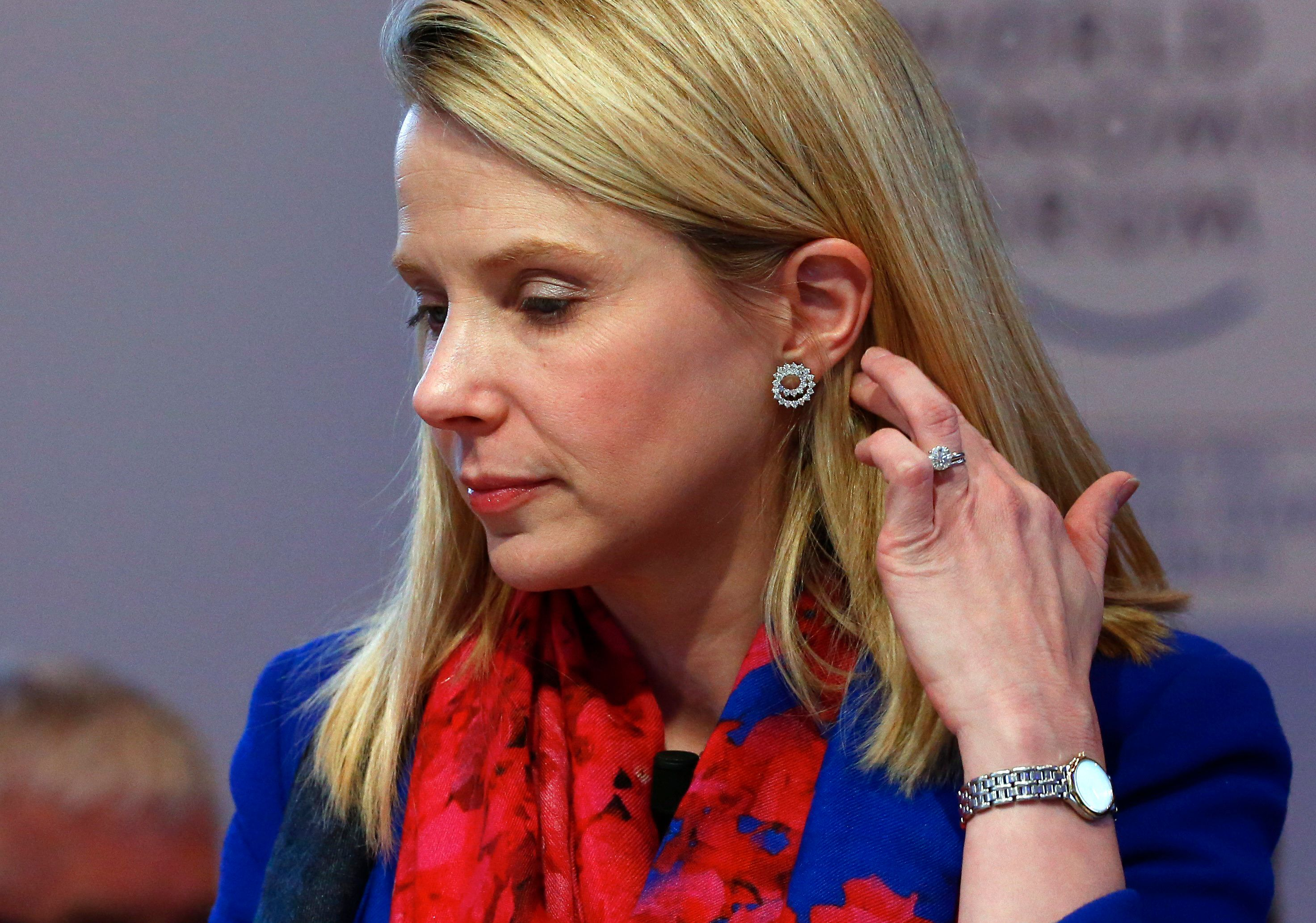 "Yahoo CEO Marissa Mayer gestures before the session ""In Tech We Trust"" in the Swiss mountain resort of Davos January 22, 2015. More than 1,500 business leaders and 40 heads of state or government attend the Jan. 21-24 meeting of the World Economic Forum (WEF) to network and discuss big themes, from the price of oil to the future of the Internet. This year they are meeting in the midst of upheaval, with security forces on heightened alert after attacks in Paris, the European Central Bank considering a radical government bond-buying programme and the safe-haven Swiss franc rocketing.                                          REUTERS/Ruben Sprich (SWITZERLAND  - Tags: BUSINESS POLITICS)"