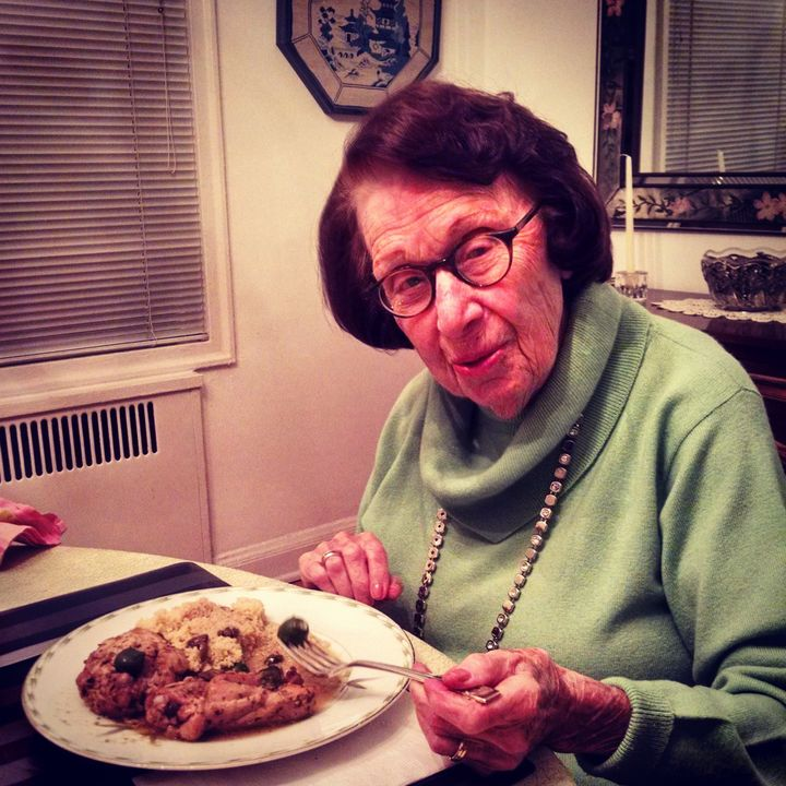Grandma Belle samples a meal cooked for her by the author.