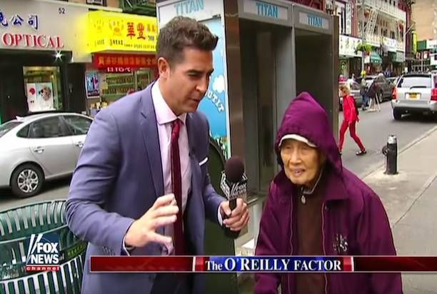 Matt Watters interviews a woman in NYC's China Town