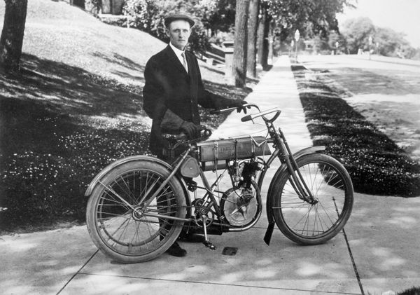 Walter Davidson, the first president of the Harley Davidson Motor Company, poses with his bike after winning the 1908 Federat