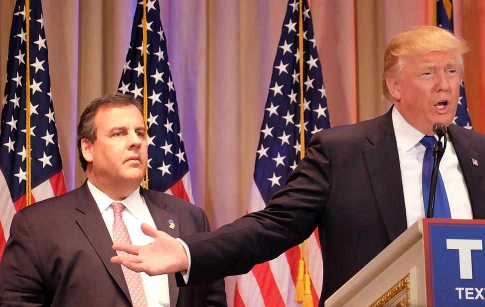 New Jersey Gov.Chris Christie (left), a former White House hopeful turned Trump supporter, listens as Trump speaks to t