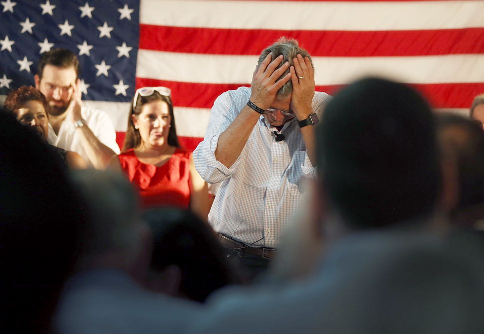 At the Sept. 12, 2015, opening of a Miami field office, former Florida Gov.Jeb Bush holds his headoverrival