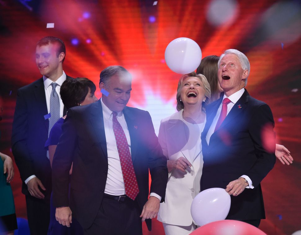Presidential nominee Hillary Clinton celebrates on the stage with (from right) former President Bill Clinton,running ma