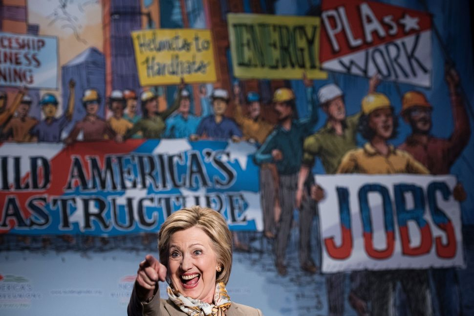 Clinton reacts while addressing the North American Building Trades Union's National Legislative Conference on April 19, 2016.