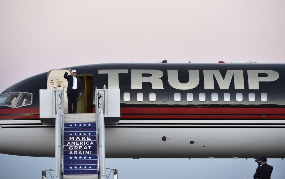 Republican nominee Donald Trump waves as he steps out of his plane for a rally at the JetCenters of Colorado in Colorado Spri