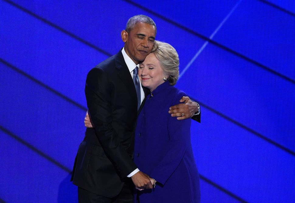President Barack Obama and Democratic nominee Hillary Clinton embrace on stage on July 27, 2016, as Day 3 of the Democratic N