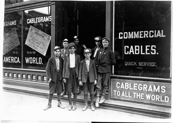 Messenger boys stand outside a telegraph office in Indianapolis, Indiana, in August 1908.