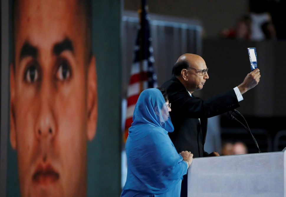 Khizr Khan, a Democratic convention speaker whose son Humayun (seen in the photo behind him) was killed serving in the U.S. A