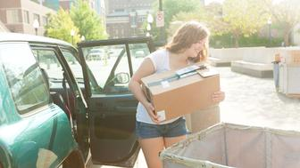 Subject: College student moving dormitory in a university campus.