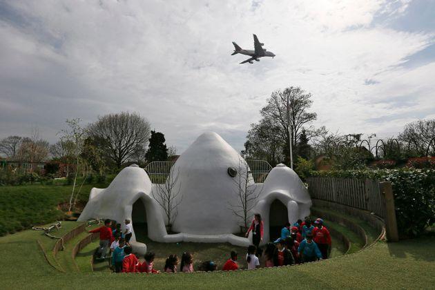 An aircraft descends overhead at Hounslow Heath Infants' School near to