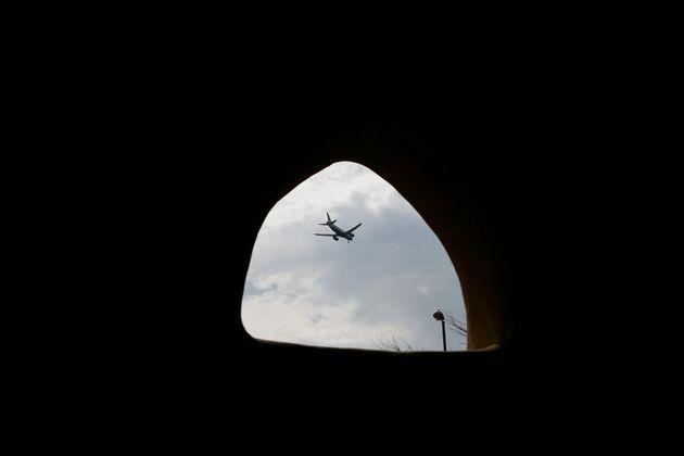 A plane passes overhead at Hounslow Heath infants