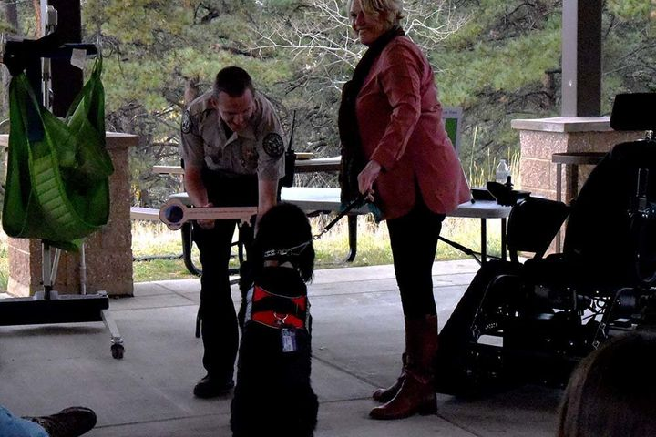 Madsen's former service dog, Sparky, presented a symbolic key to Staunton Park manager Zach Taylor during the ceremony.