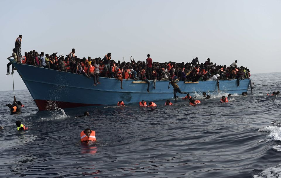 Refugees and migrants wait to be rescued by Proactiva Open Arms NGO in the Mediterranean Sea, some...