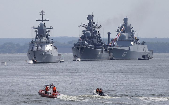 (L-R) Russian navy corvette Steregushchy, destroyer Nastoichivy and frigate Admiral Gorshkov are anchored in a bay of the Rus