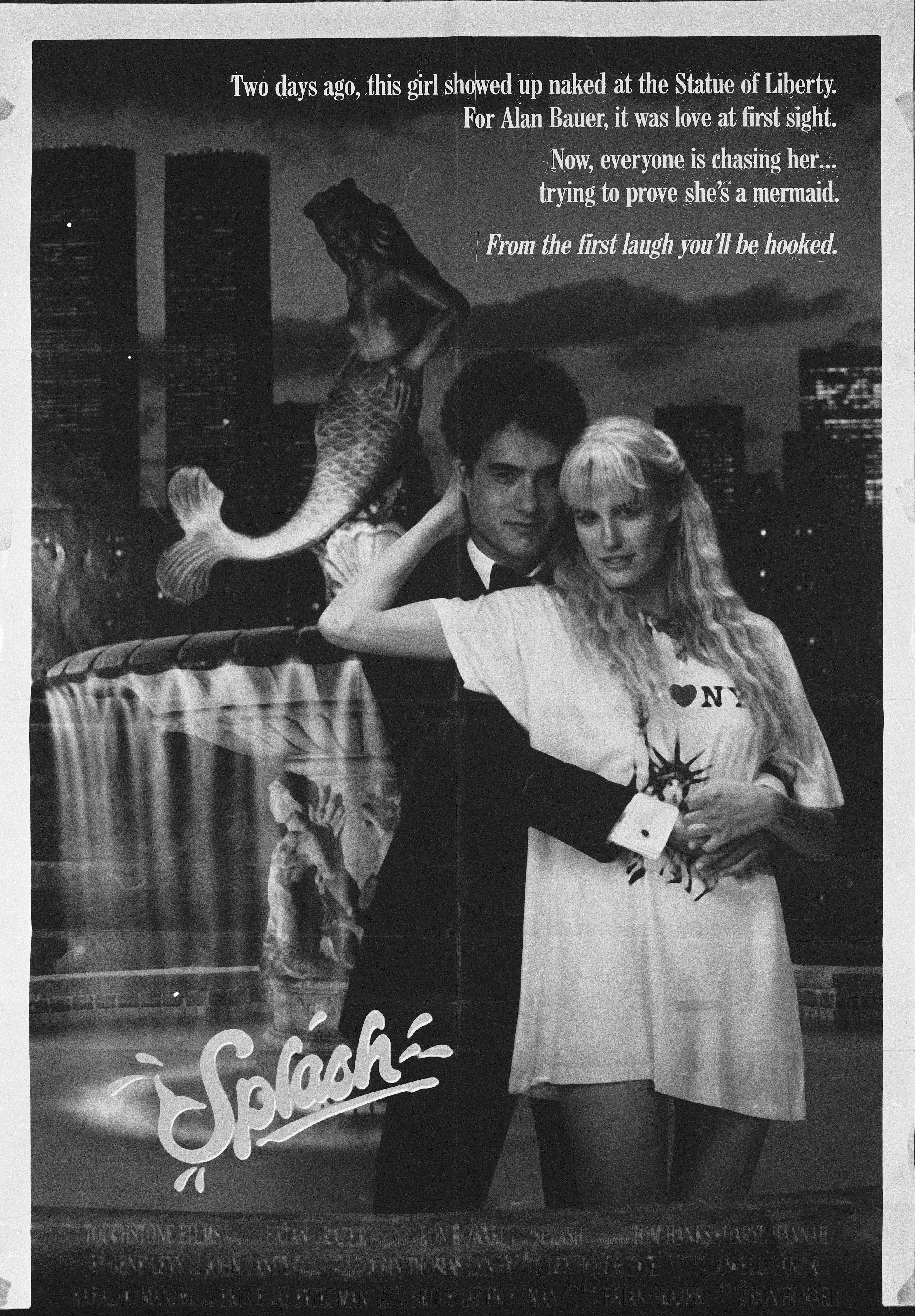 A movie poster for the film 'Splash' features American actors Tom Hanks and Daryl Hannah, 1984. (Photo by Hulton Archive/Getty Images)