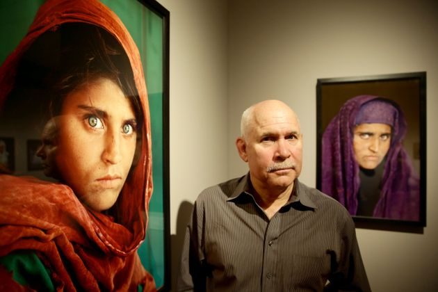 U.S. photographer Steve McCurry beside his famous