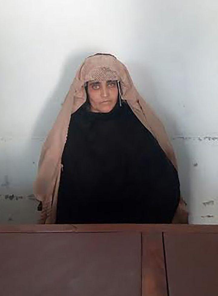 Sharbat Gula waits for a court hearing in Peshawar, Pakistan.