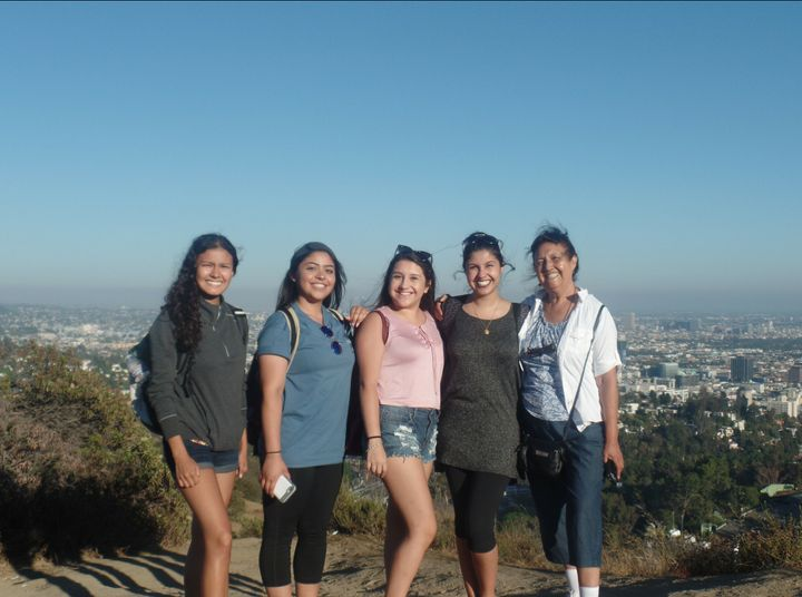 Ruiz, left, with her cousins and grandmother, right, at a spot overlooking Los Angeles.