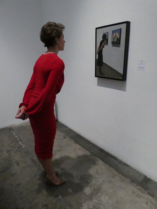 Jane Allen admiring On Closer Examination (a work featuring herself in last year's exhibition)