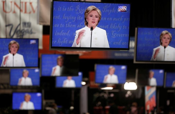 Democratic U.S presidential nominee Hillary Clinton is shown on TV monitors in the media filing room on the campus of Univers