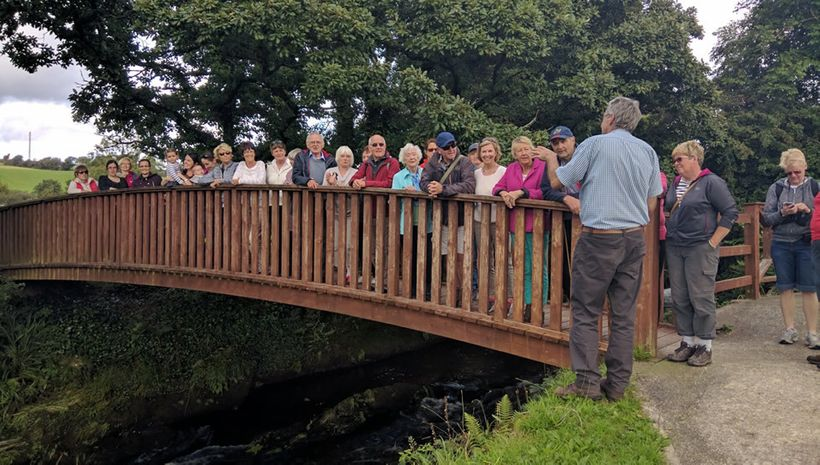 Hikers pause to hear history commentary