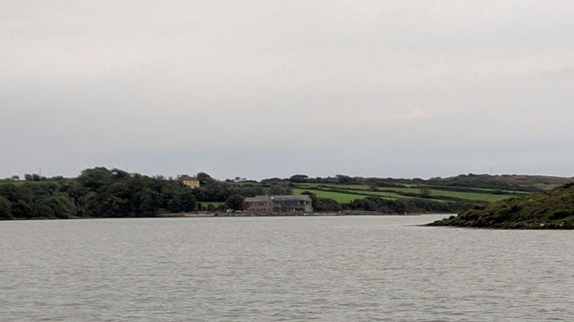 The Ilen River flows toward the sea