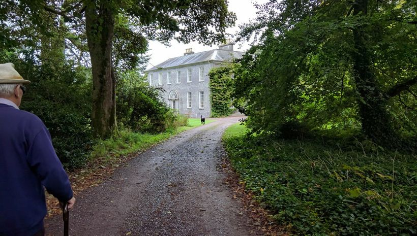 Robert Townshend led up the path to Drishane House
