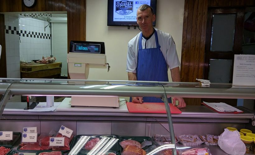 Haulie O'Neill raises cattle to produce the meats and sausages sold in his butcher shop