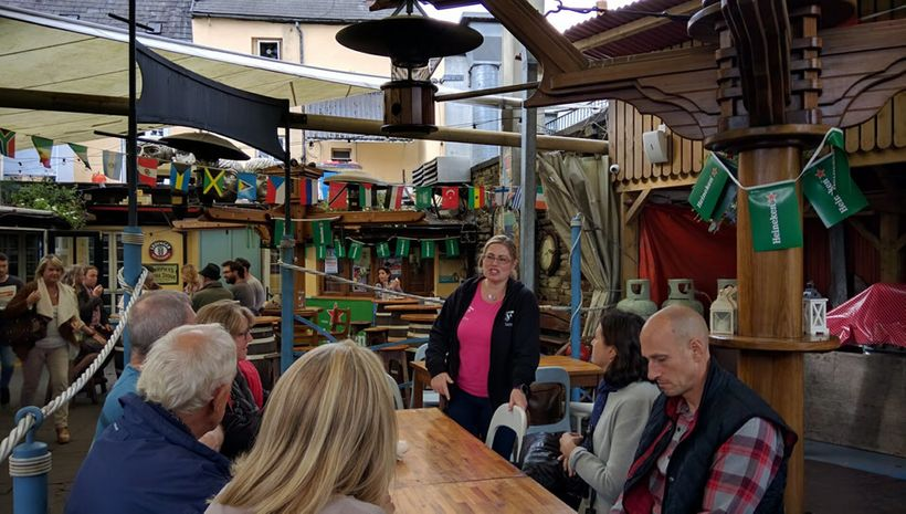 The tour concludes at a friendly outdoor pub