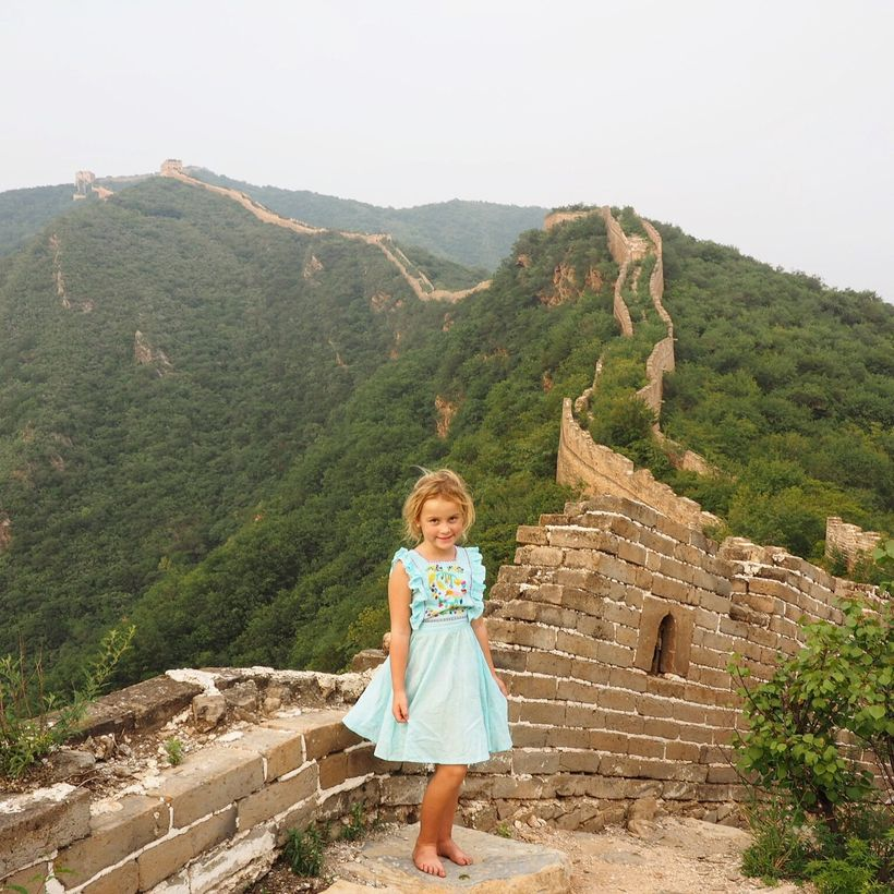 Emmie at the top of the Great Wall of China
