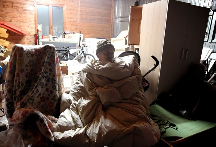 A person rests in a secured area after earthquakes hit the village of Visso, central Italy on Wednesday.