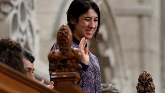 Nadia Murad Basee Taha, United Nations Goodwill Ambassador for the Dignity of Survivors of Human Trafficking, waves while being recognized by the Speaker in the House of Commons on Parliament Hill in Ottawa, Canada, October 25, 2016. REUTERS/Chris Wattie