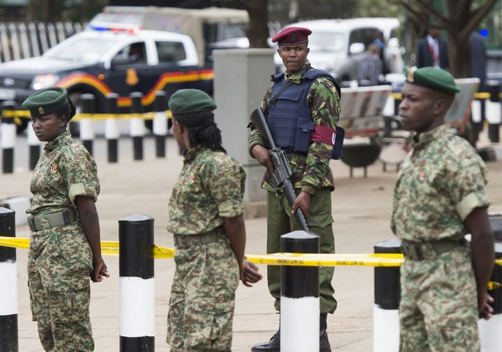 Kenyan security forces stand outside the Memorial Park in Nairobi on July 25, 2015.