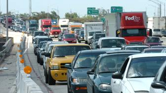 Shortly before noon, traffic backs up on Interstate 4 as cars exit for the T.D. Waterhouse Center, the starting point of the march for immigration reform in Orlando, Florida Monday, May 1, 2006.  (Photo by Joe Burbank/Orlando Sentinel/MCT via Getty Images)