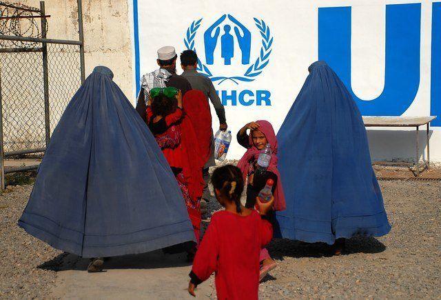 Afghan refugee families living in Pakistan arrive at the UNHCR's repatriation center in Peshawar, before returning to A