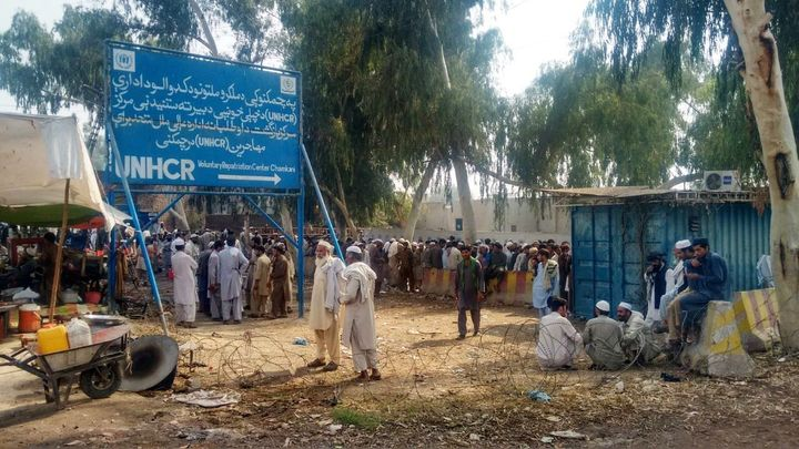 Long queues of Afghan refugees stretch out near the UNHCR repatriation center outside the Pakistani city of Peshawar.