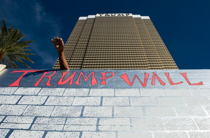 Protesters erect a cardboard wall in front of the Trump International Hotel Las Vegas during the Culinary Union's Wall of Taco Trucks protest on Oct. 19.