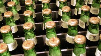 UNITED STATES - JUNE 29:  Full bottles of lager await to be loaded into cases at the Yuengling brewery in Pottsville, Pennsylvania, Wednesday, June 29, 2005. The U.S. economy grew at a 3.8 percent annual rate from January through March, matching the pace in the previous three months and suggesting Federal Reserve policy makers will keep raising interest rates.  (Photo by Mike Mergen/Bloomberg via Getty Images)